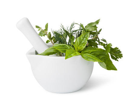 mortar and pestle medicine: mortar with herbs isolated on a white background Stock Photo