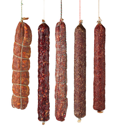 dry sausage: salami sausages isolated on white background Stock Photo