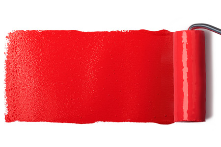 red paint roller: roller brush with red paint