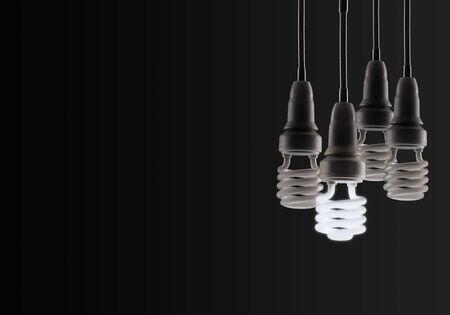 fluorescent light: Energy saving fluorescent light bulb isolated on a black bakground