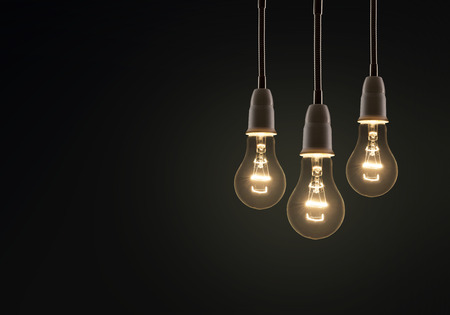 electric bulb: light bulb isolated on a black bakground Stock Photo