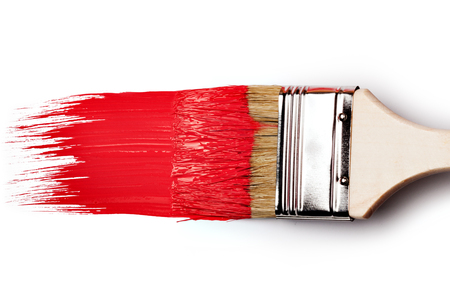 roller brush: Paintbrush with red paint isolated over white background