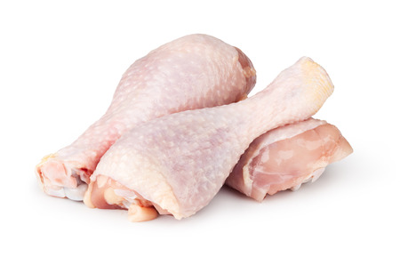 Pieces of raw chicken meat on a white background Stockfoto