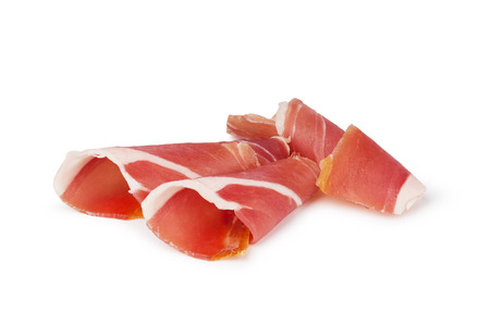sliced prosciutto on a white background