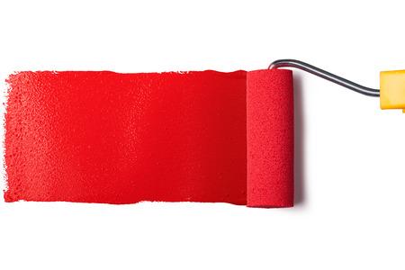 赤いペンキとローラー ブラシ 写真素材
