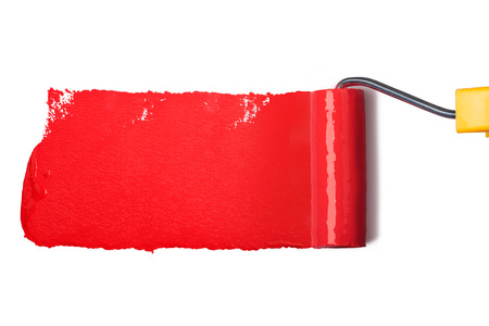 roller brush with red paint photo