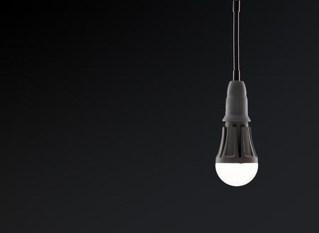 Energy saving LED light bulb isolated on a black bakground
