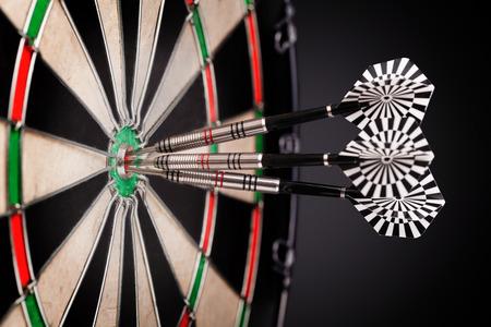 dart board: darts arrows in the target