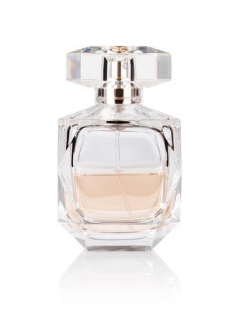 白い背景の上の香水瓶 写真素材