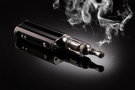 big electronic cigarettes isolated on black Banque d'images