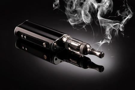 big electronic cigarettes isolated on black Stockfoto