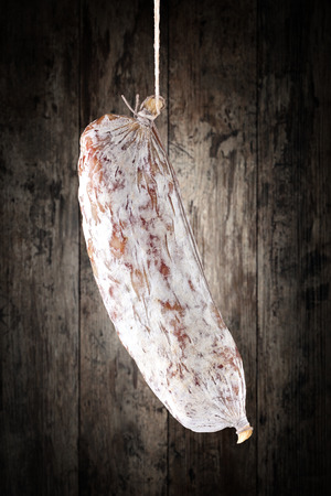 salami: salami on a wooden background Stock Photo