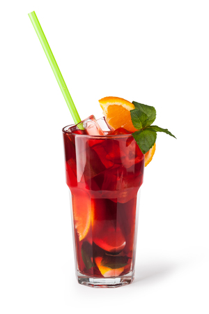 Glasses of fruit drinks with ice cubes isolated on white