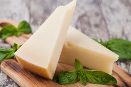 parmesan cheese: parmesan cheese on wooden background