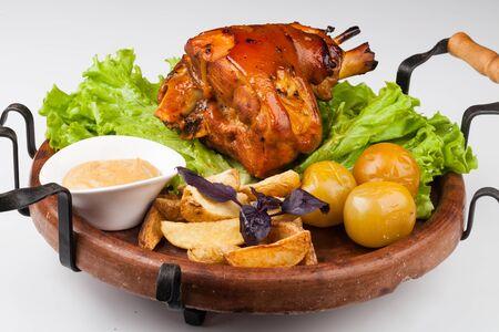 Appetizing roast pork knuckle on cutting board Stock Photo
