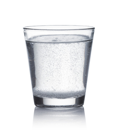 effervescent: glass of mineral water on white background Stock Photo