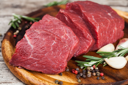 Raw beef meat on a cutting board Stock Photo - 43203372