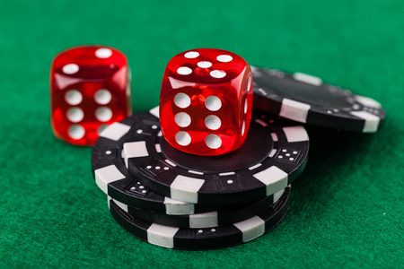 red dice: Red dice and chips on green table