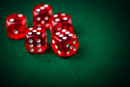 red dice: Red dice on a green felt Stock Photo