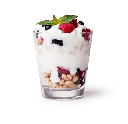 ミューズリーと白い背景の上の果実とヨーグルト 写真素材