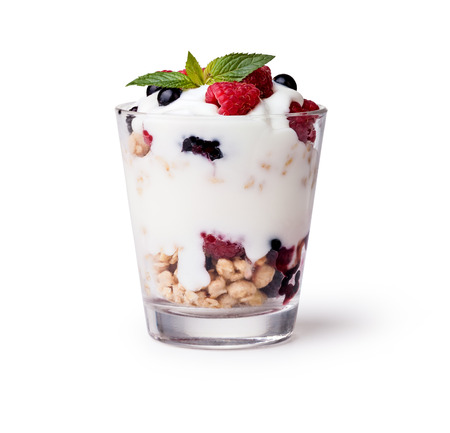 yogurt with muesli and berries on white background Imagens