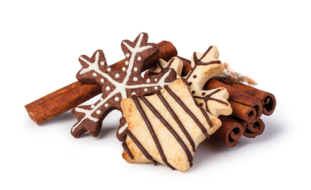 Homemade christmas cookies on wooden table, isolated on white background