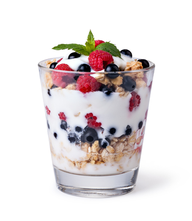 yogurt with muesli and berries on white background Фото со стока