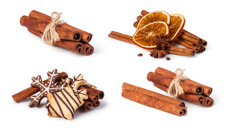 christmas scent: dried oranges and cinnamon isolated on white background