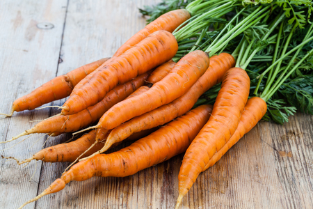 carrot: fresh carrots bunch on wood