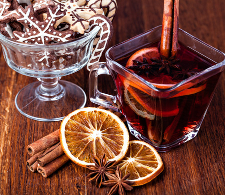 punch spice: Mulled wine and spices on wooden background
