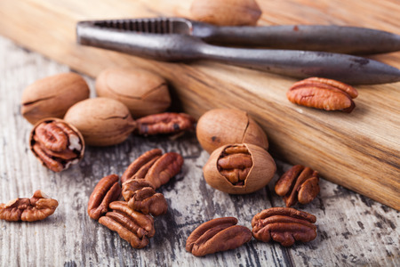 pecans: Pecan nuts on a wooden table Stock Photo