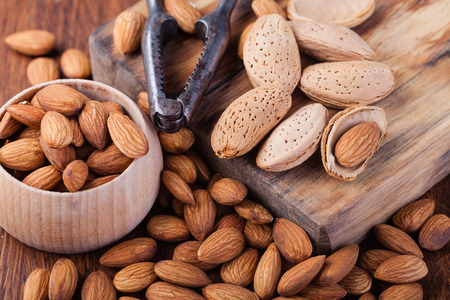 almond: almonds nuts on a wooden table Stock Photo