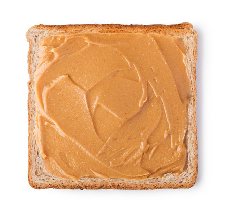peanut butter on a slice of toast isolated on a white background