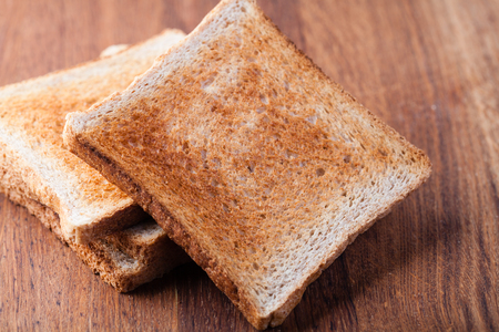 toasted: toasted bread, on a wooden Stock Photo