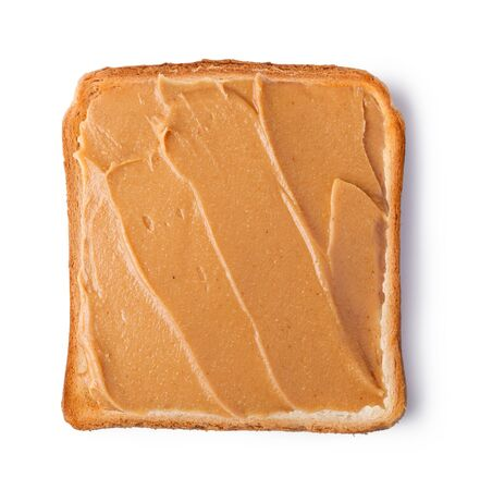 sandwich spread: peanut butter on a slice of Toast. Isolated on a white background