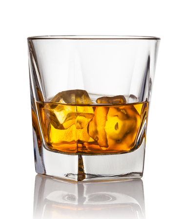 Glass of whiskey and ice on a white background