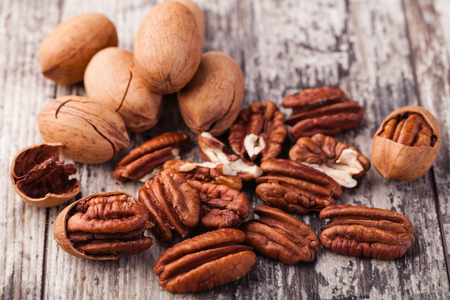 pecan: Pecan nuts on a wooden table Stock Photo