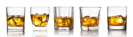 Glass of scotch whiskey and ice on a white background Stockfoto