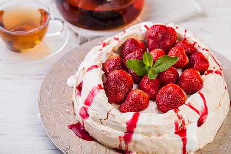 Pavlova cake with fresh strawberries