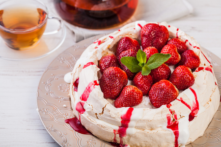 Pavlova cake with fresh strawberries