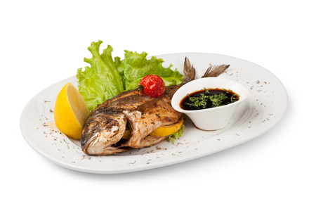 dorade: Grilled bream fish on a plate