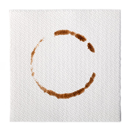 two object: paper Napkin with a coffee stain isolated on white background