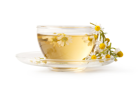 chamomile tea: Cup of medicinal chamomile tea isolated on white background Stock Photo