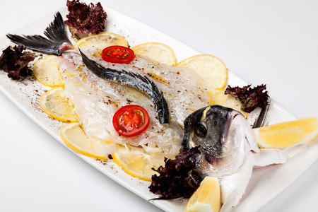 white fishand and  lemon, on a plate