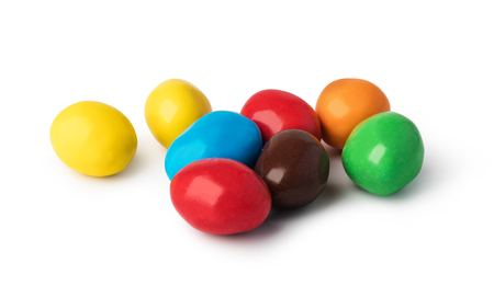 colorful chocolate buttons on a white background
