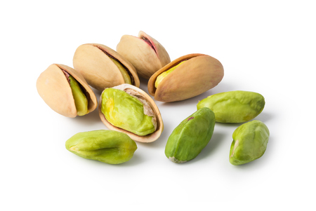 Pistachio nuts. Isolated on a white background. Фото со стока