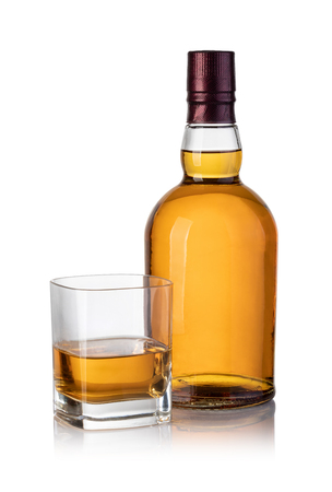 whiskey bottle and glass isolated on white background