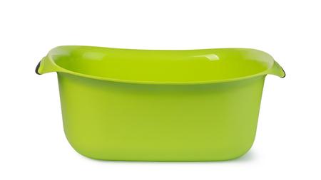 Green plastic wash bowl. White