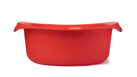 Red plastic wash bowl. White Banco de Imagens