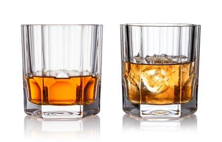 Glass of whisky and ice isolated white background Stockfoto